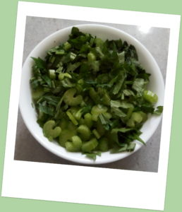 Bowl of chopped celery and leaves