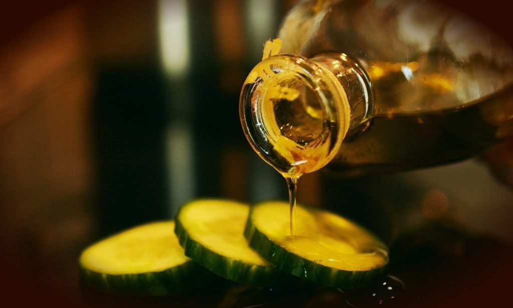 olive oil poured on cucumbers