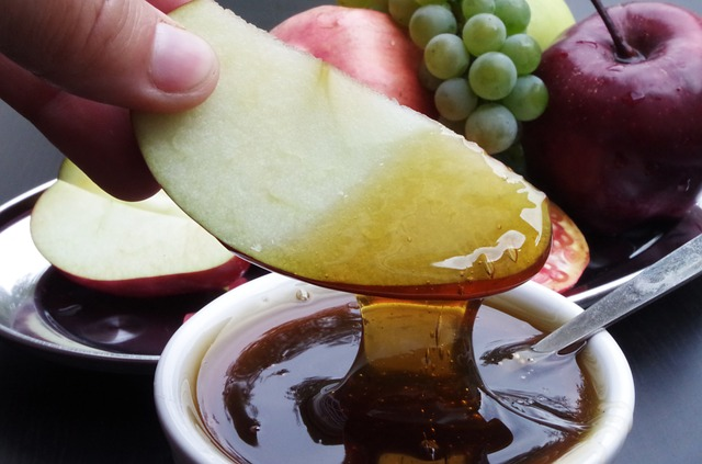 Dipping an apple in honey