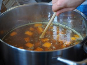 stirring pot of soup