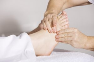 reflexologist working on foot
